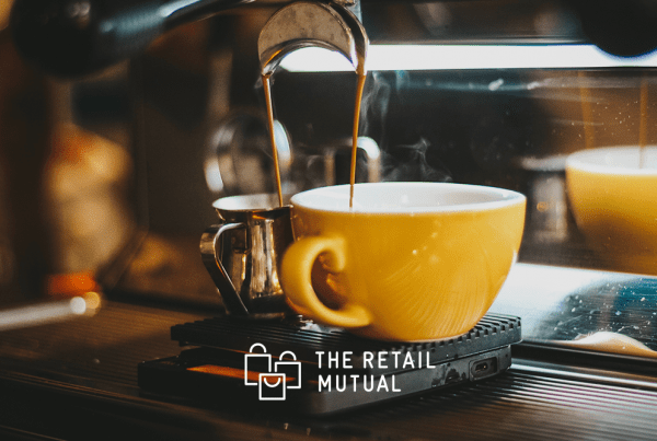 coffee pouring into yellow coffee cup