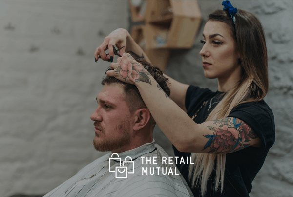 lady cutting a mans hair in a barbers