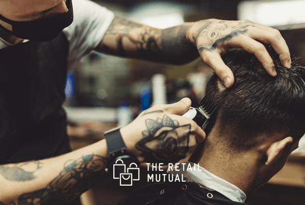 barber giving a cut wearing a face mask